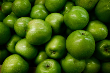 Bright green apples with glare