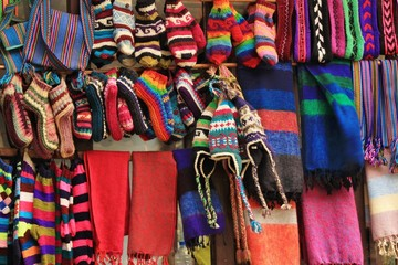 Colorful handcraft displayed in a store in the Langtang National Park, Nepal. Colorful woolen socks, cloves, capes and more to keep warm in the Himalayas.