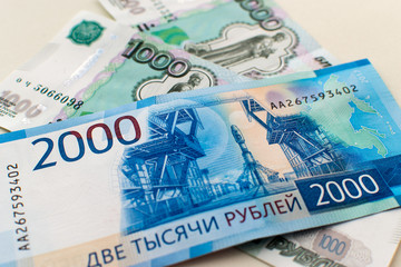 New 2000 and 1000 rubles close-up. Background.