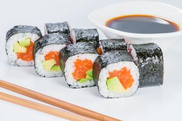 Tasty fresh Sake Avocado Maki sushi with rice, avocado and salmon on light background