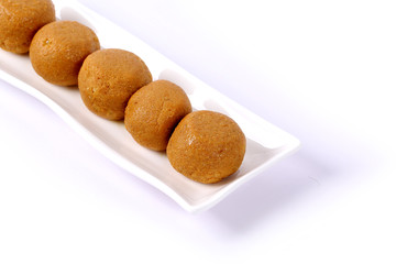 Besan Laddoo - Roasted gram flour mixed with Desi Ghee and sugar to make tasty and round shape sweet Laddu. selective focus
