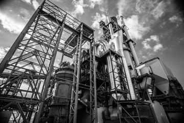 Looking up perspective of big plant near the Novorossiysk, Black Sea coast. Industrial, futuristic architecture.