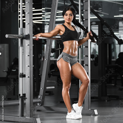 4906239ec1fb Sexy athletic girl working out in gym. Fitness woman doing exercise. Sexy  beautiful butt in thong