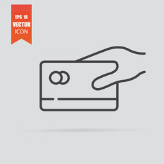 Hand holding credit card icon in flat style isolated on grey background.