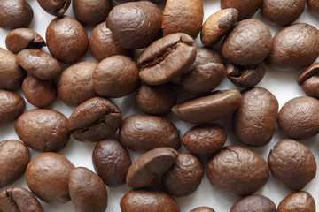 Roasted coffee beans. Isolated on white. Abstract background.
