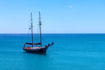 View of retro ship on blue sea. Greece.