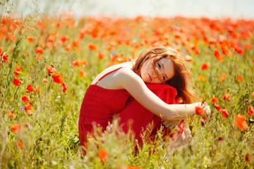 beautiful girl in poppy field
