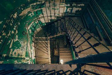 Square spiral staircase in an abandoned house