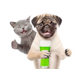St Patrick's Day concept. Cat and dog with a glass of green beer. isolated on white background