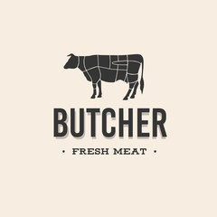 Butcher shop logo. Butchery label with sample text. Scheme and the silhouette of a cow.
