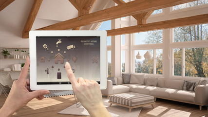 Smart remote home control system on a digital tablet. Device with app icons. Interior of modern living room in the background, architecture design.