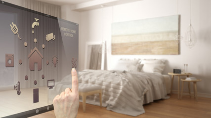 Smart home control concept, hand controlling digital interface from mobile app. Blurred background showing modern bedroom, architecture interior design
