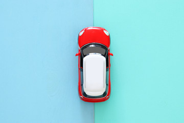 top view photo of toy car over wooden background.