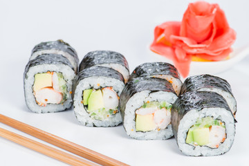 Appetizing fresh set of sushi rolls with rice, cream cheese, salmon, cucumber and caviar on light background