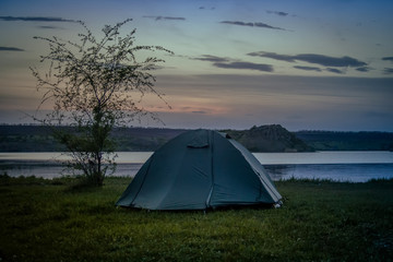 Tourist tent camping on the river bank. Southern Bug. Ukraine
