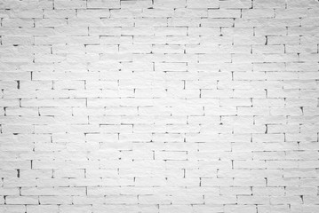 Brick wall background painted texture in stained old aged stucco light white cream gray color