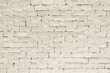 Old aged rough brick wall texture background painted in light cream sepia color in grunge style