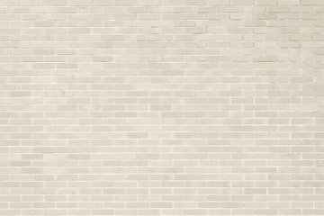 Brick wall texture pattern background in natural light cream beige brown color