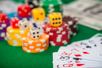 Poker chips on table in casino. Cards on green felt casino table