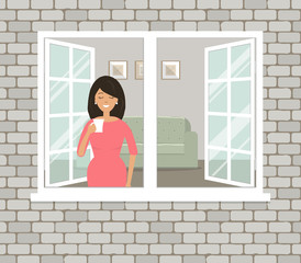 A young woman in red dress is drinking coffee by the open window. View of the room from the street side. There is a sofa and paintings on the wall in the living room. Vector illustration