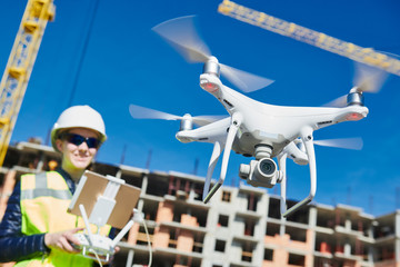 Drone operated by construction female worker on building site Wall mural