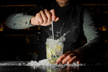Bartender making cocktail at the bar counter