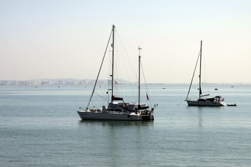 Sailing yachts in the harbor of the seaport of Cadiz on the coast of the Bay of Cadiz in the Atlantic Ocean.