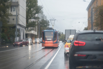 Tram in Moscow, Russia. Heavy traffic on the road