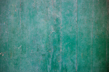 Weathered green painted wooden background partly faded