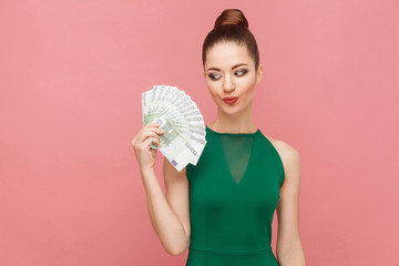 Woman looks with desire on money