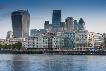 Thames embankment and london skyscrapers in City of London in the sunrise time.