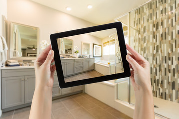 Master Bathroom Interior and Hands Holding Computer Tablet with Photo on Screen