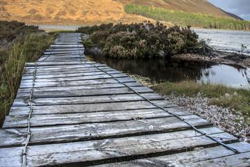 Footbridge at Loch Muick. Cairngorms National Park. Ballater, Aberdeenshire, Scotland, UK. Royal Deeside.