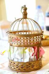 Wedding decoration. Flower in a decorative cage.
