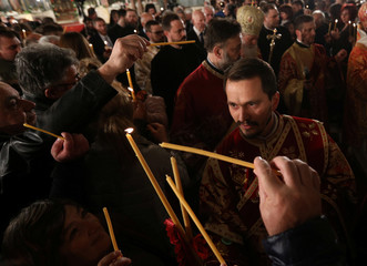 Worshippers light their candles during the Orthodox Easter service in Alexander Nevsky Cathedral in Sofia