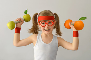 Kid, child, lifts weights from apples oranges.
