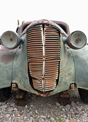 Front view of vintage car with rusted radiator