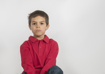 Handsome little boy in red shirt, isolated on white background