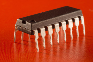 electronic chip on red background