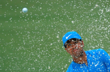 Tony Finau of the U.S. watches his ball during third round play of the 2018 Masters golf tournament in Augusta