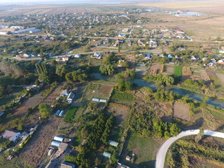 View from the top of the village. Houses and gardens. Countryside, rustic landscape. Aerial photography