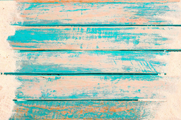 Beach background - top view of beach sand on old wood plank in blue sea paint background. summer vacation concept. vintage color tone. Wall mural