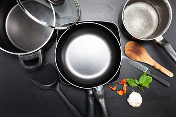 Top view frying pan and pot on black leather table image for cooking background and food design background.