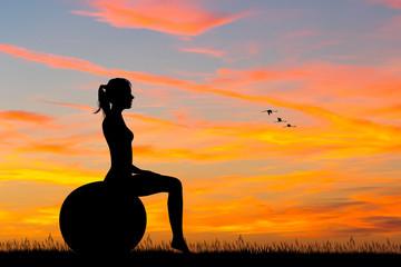 girl do pilates at sunset