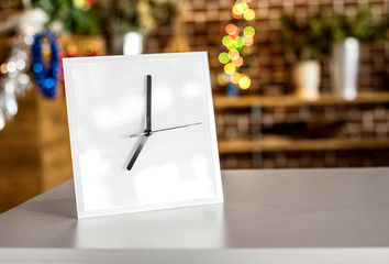 White clock on modern shelf. Mirror frame or interior room decoration.