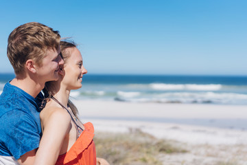 Romantic young couple enjoying a day at a beach