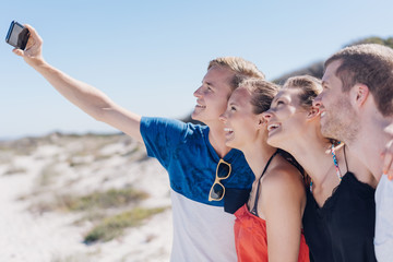 Fun loving group of friends posing for a selfie