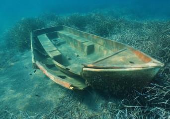 A small boat wreck underwater on a seabed with Neptune grass, Mediterranean sea, Catalonia, Costa Brava, Spain