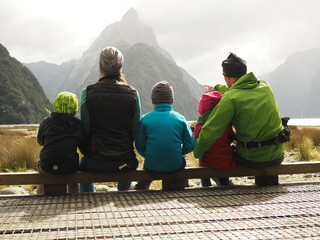Family looking at mountains Wall mural