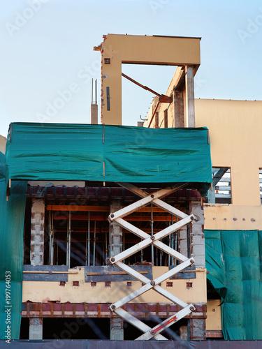 Under constructions  scissor lift holding a wall of a renovating